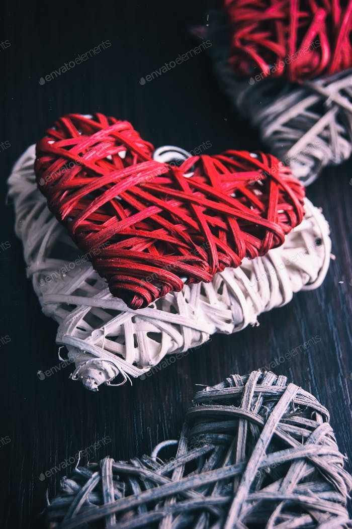 Valentines design - Heart in chains. Love concept on wooden background.
