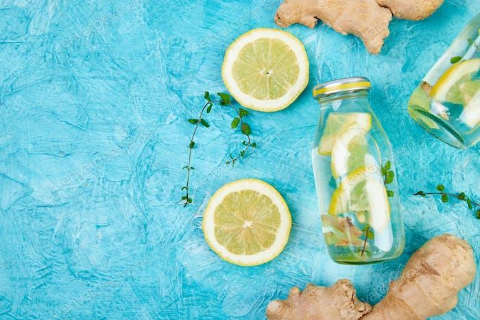 Detox water in bottles with ingredients, ginger, lemon, mint
