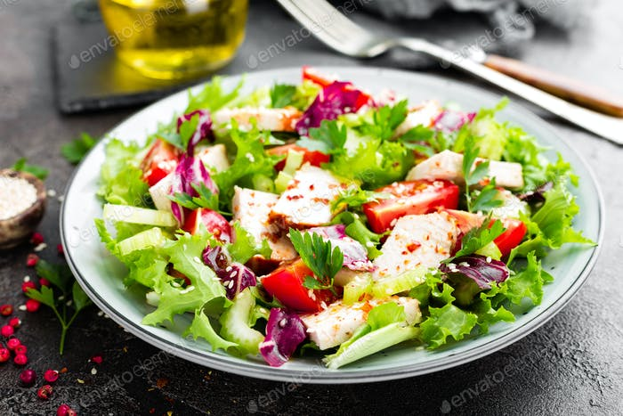 Meat salad with fresh vegetables. Vegetable salad with baked chicken breast