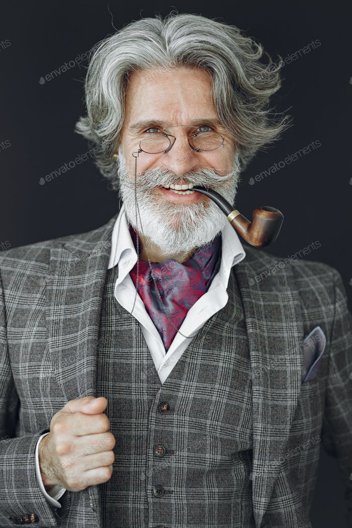 Elegant senior man with a smoking pipe