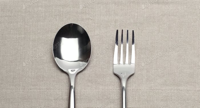Fork and spoon on canvas napkin