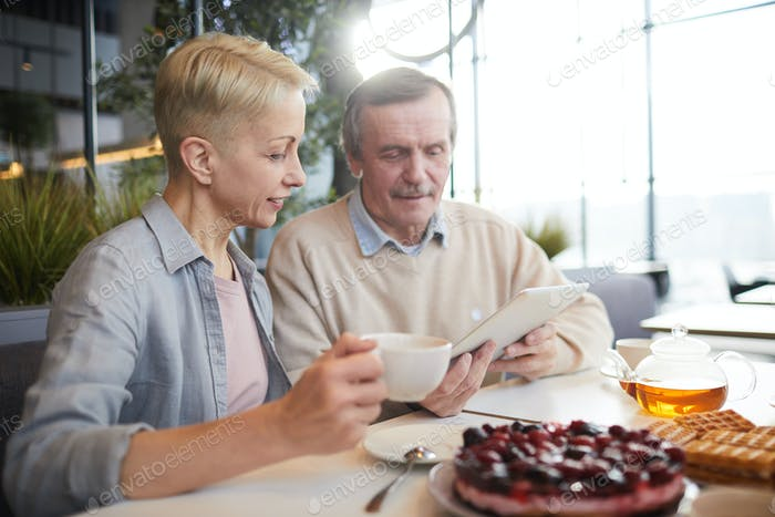 Mature couple sitting in cafe