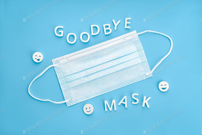 Goodbye mask phrase and face mask isolated on blue background.