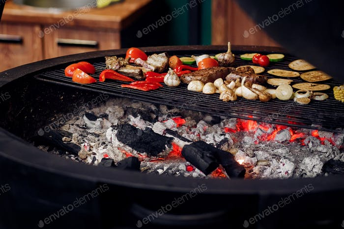Juicy vegetables and meat grilling