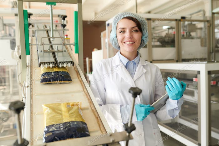 Young  Woman Posing at Packaging Line