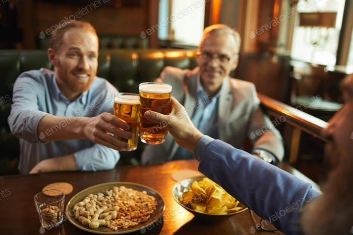 People toasting with beer