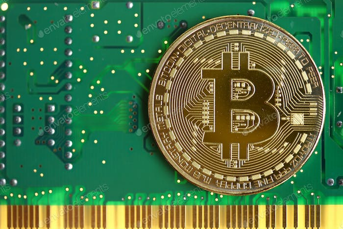 Bitcoin with green circuit board