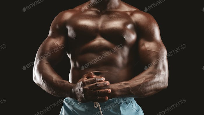 Hot athletic body of african male bodybuilder