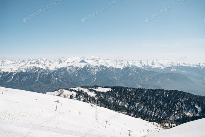 Winter mountains, ski run. The view of the mountains and ski lift