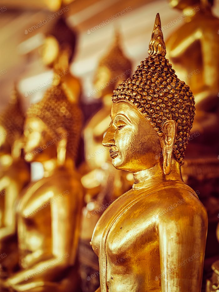 Golden Buddha statues in buddhist temple