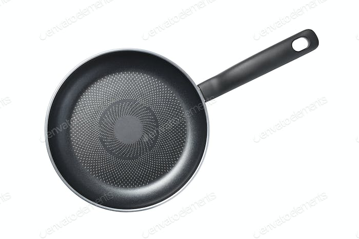 Black skillet with non-stick coated surface isolated