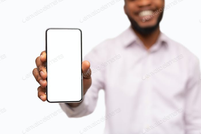 Smartphone with blank screen in hands of unrecognizable african man