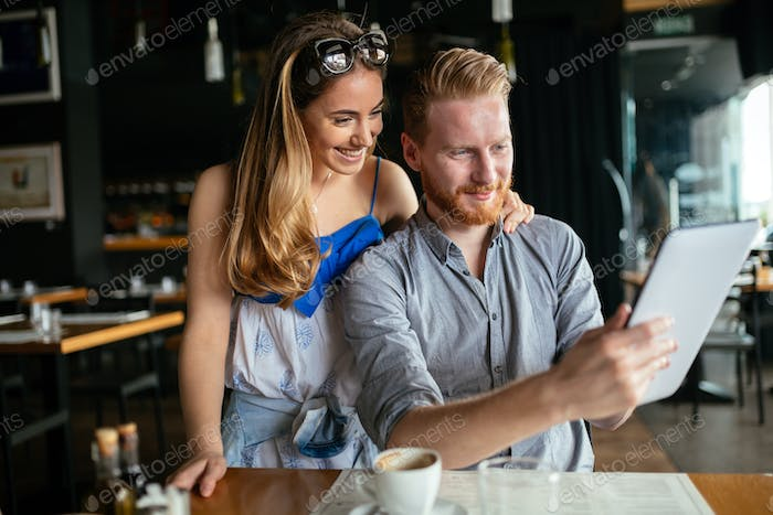 Woman and man flirting in cafe