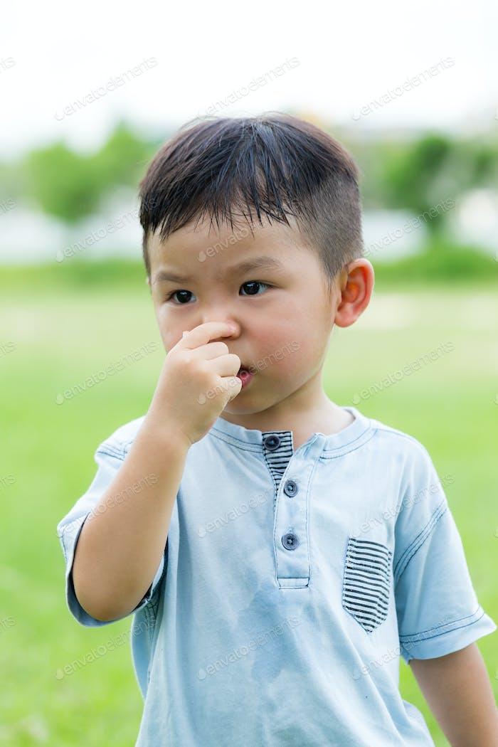 Little boy pinch on nose