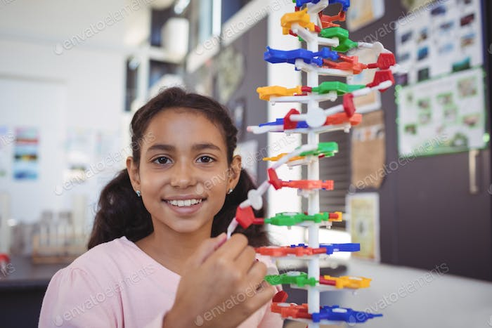 Portrait of smiling elementary student by model