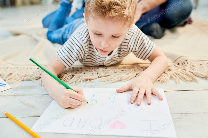 Little Boy Wrapped up in Drawing