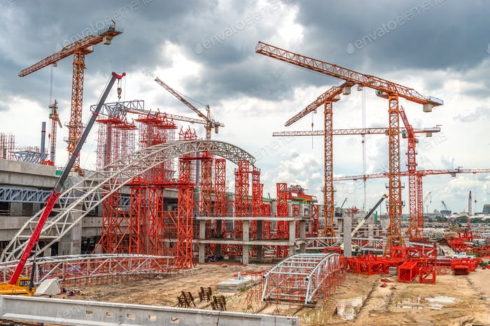 Cranes Working on Expressway Construction Site in Asia