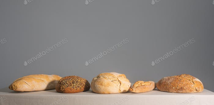 Bread on a table covered with a tablecloth