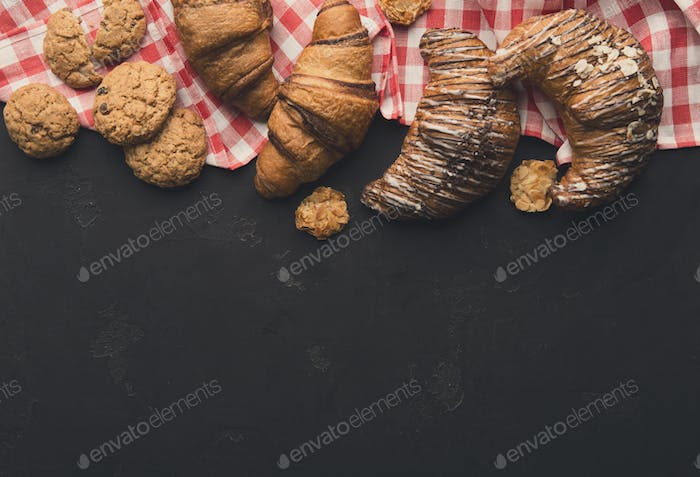 Homemade french croissants and cookies on wood
