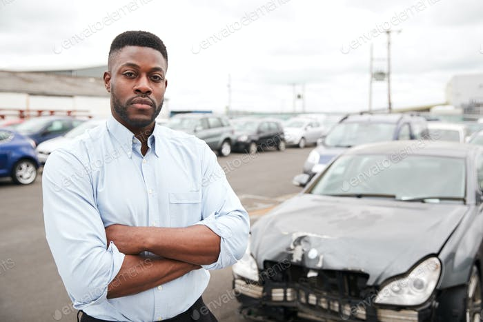 Portrait Of Motorist Standing Next To Car Damaged In Motor Accident