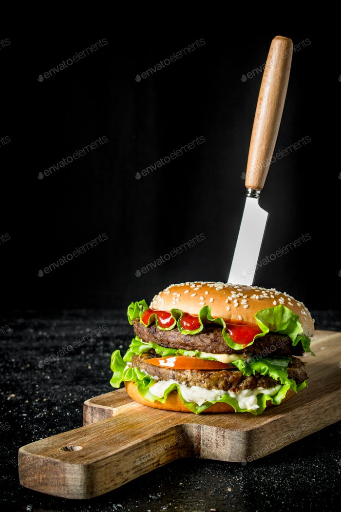 Burger with a knife.