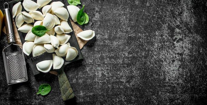 Raw dumpling. Cooking homemade dumplings with potatoes.