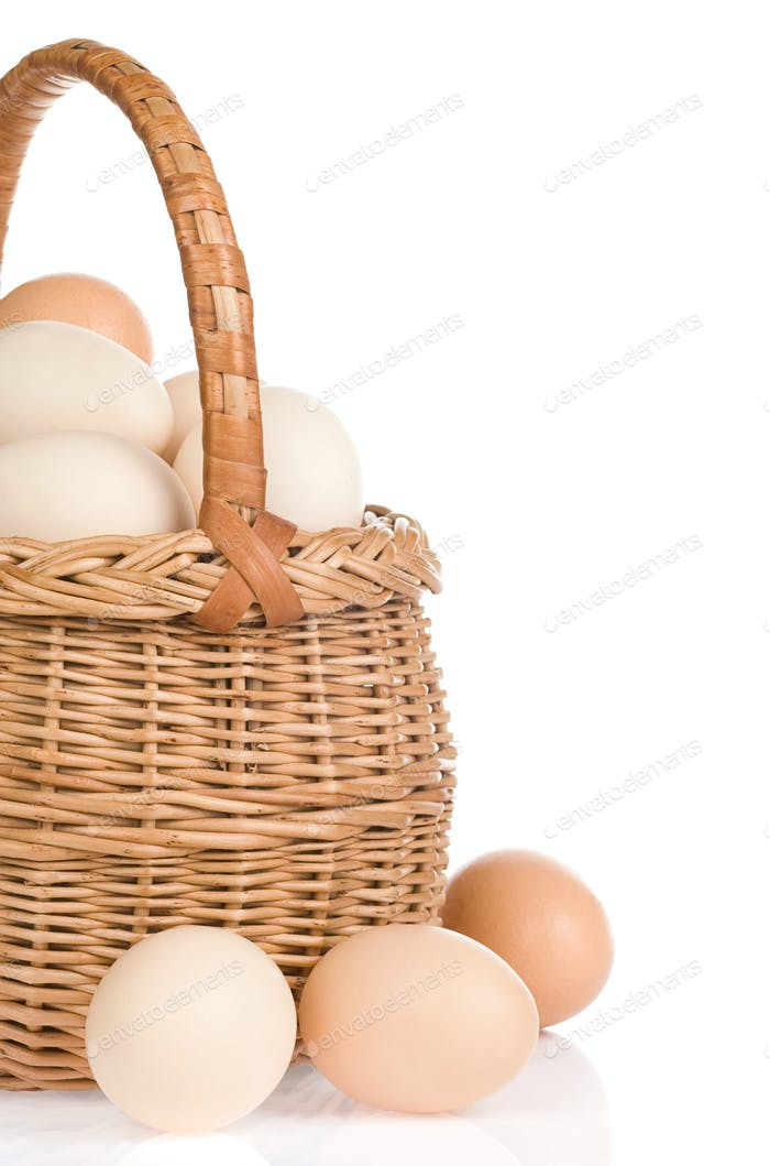 eggs and basket on white background