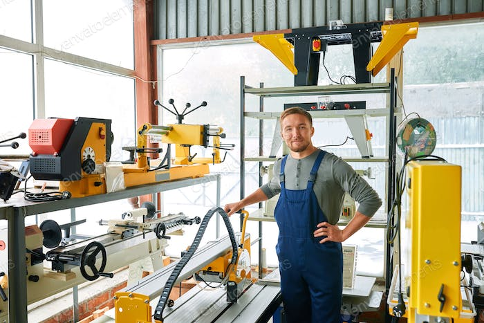 Young Workman Posing at Factory