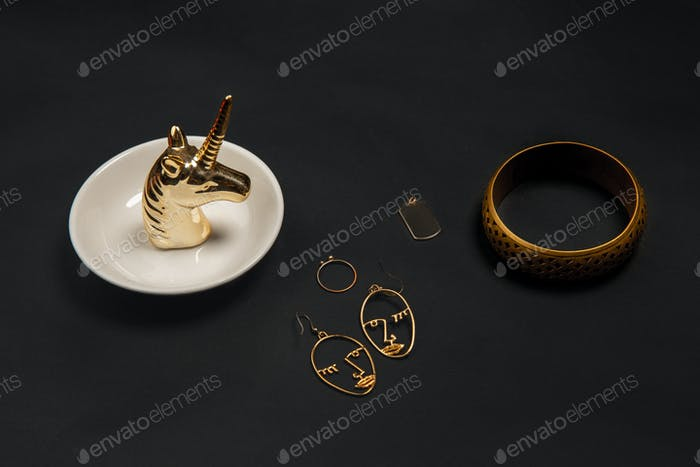 Fashion look. Monochrome stylish composition in black and gold colors. Top view, flat lay