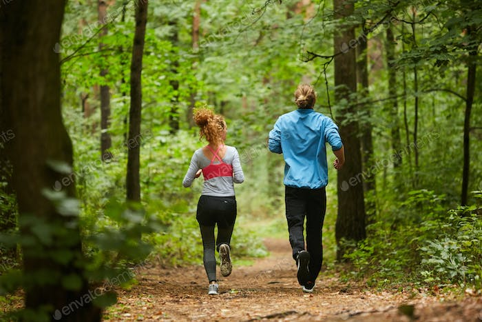 Jogging on forest path