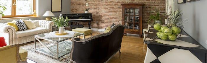 Elegant living room with brick wall