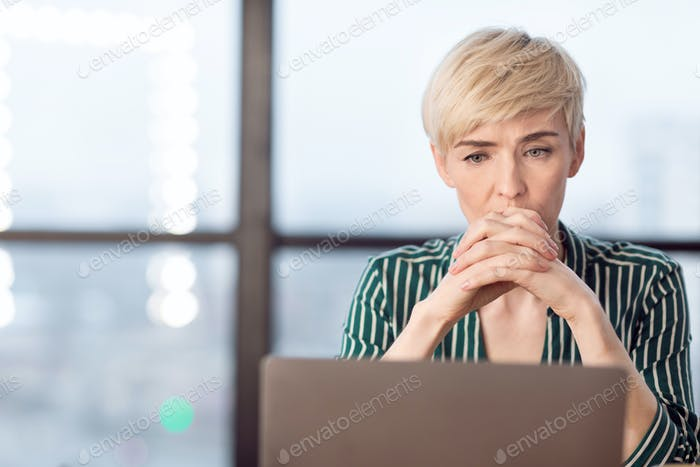 Anxious Business Woman Thinking On Probems Sitting In Modern Office