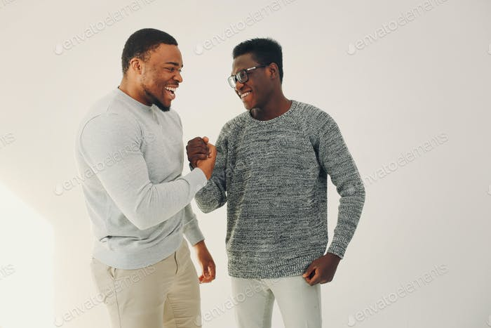 Handsome black men standing on a white background