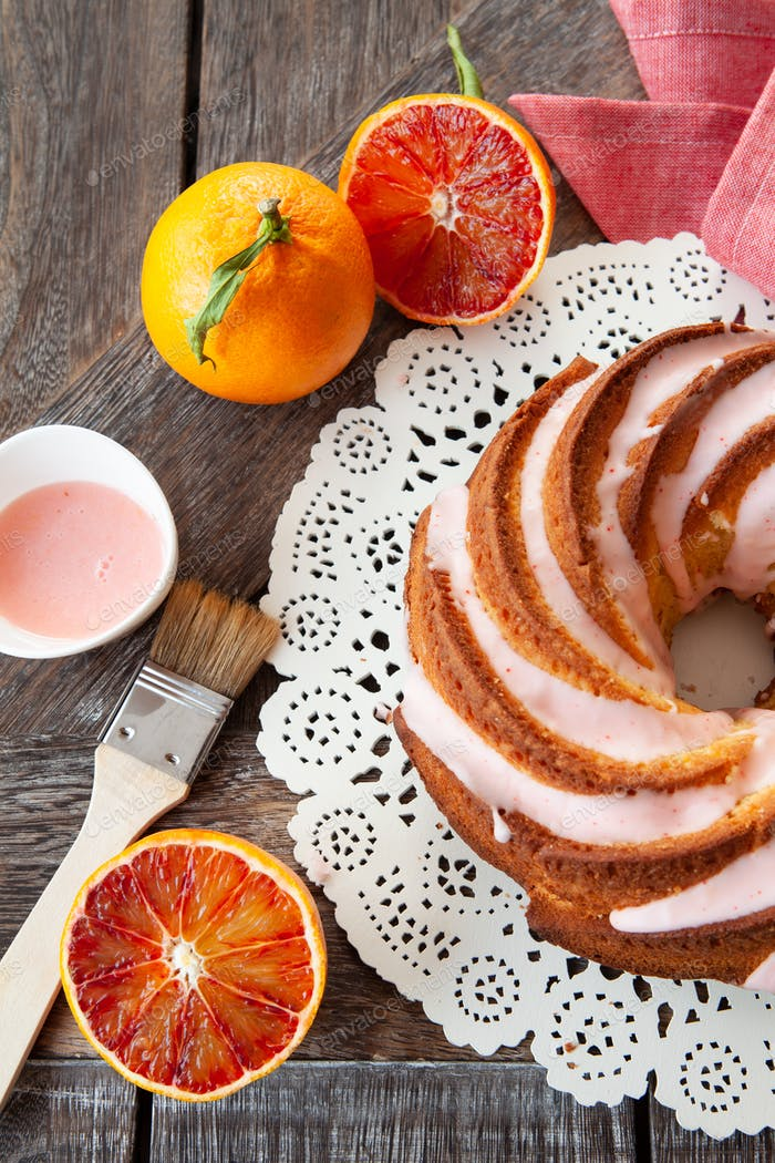Tasty bundt cake with pink frosting