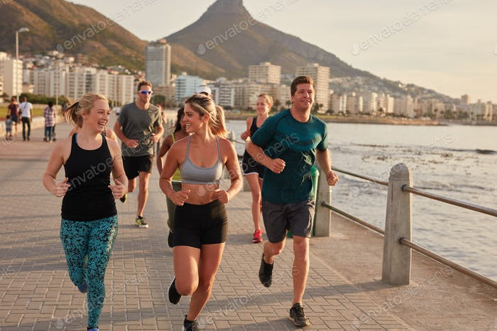 Fit young runners training on seaside promenade