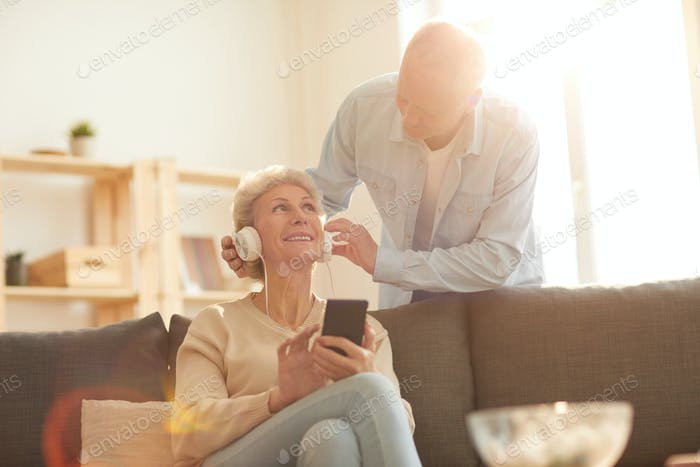 Senior Couple Using Devices