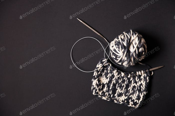 Close-up of knitting on black background