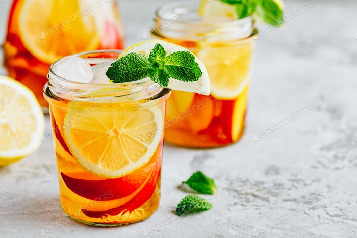 Cold peach and lemon iced tea. Summer refreshing drink