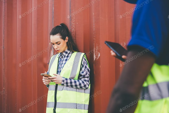 Construction female worker on chatting on mobile phone