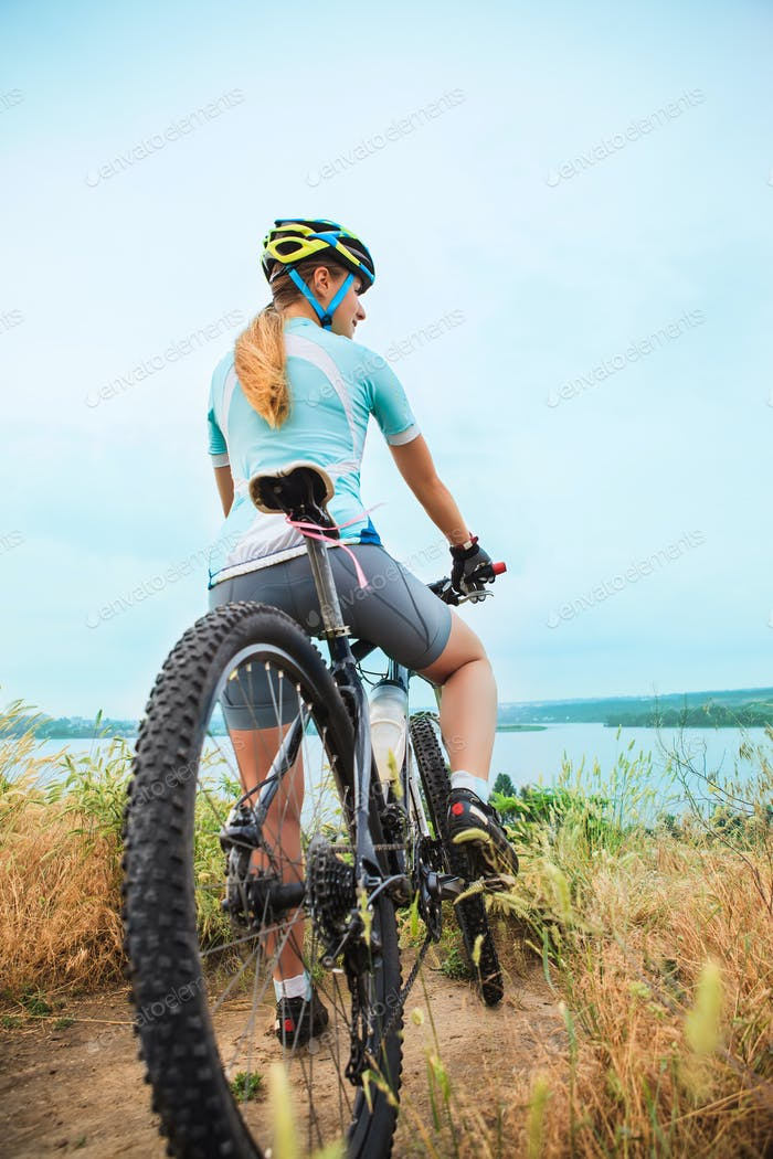 Young girl riding bicycle outside. Healthy Lifestyle.
