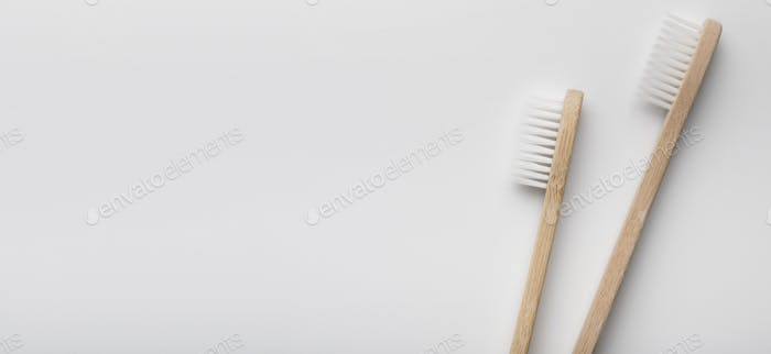 Natural bamboo toothbrushes isolated on white background