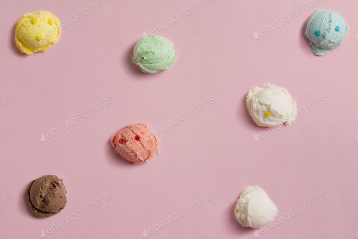 pattern of balls of natural colorful ice cream on a pink background