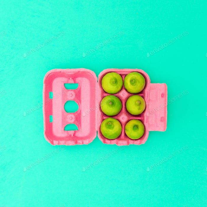 Egg box with limes Minimal design art. Creative Idea