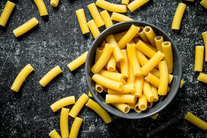 Pasta background. Dry pasta in a bowl.