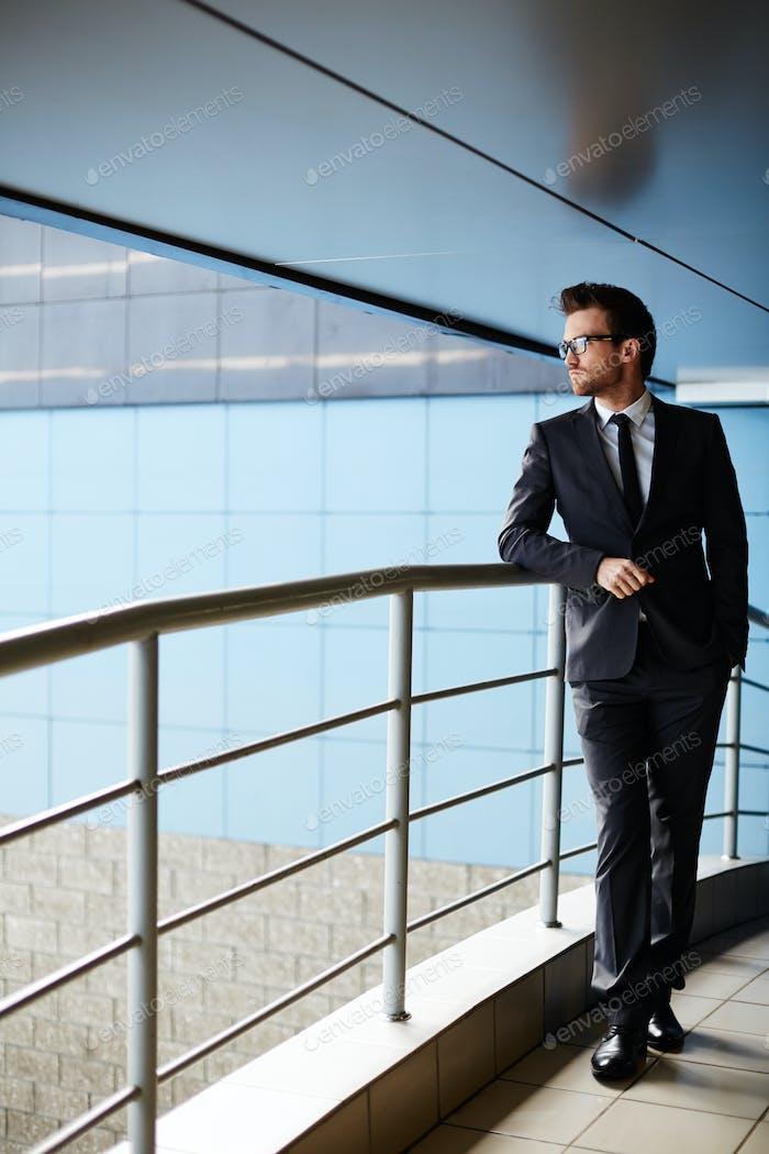 Businessman by railings