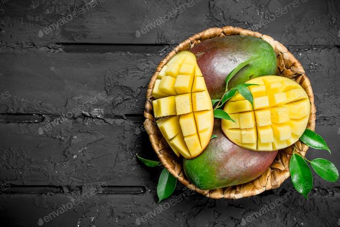 Aromatic fresh mango in a basket.