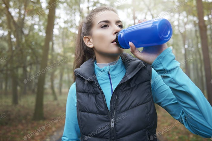 Thirsty woman after the hard training