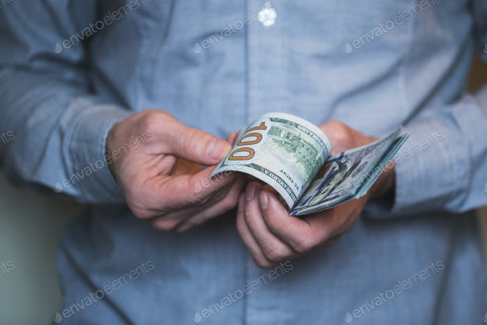 Businessman holding money in his hands