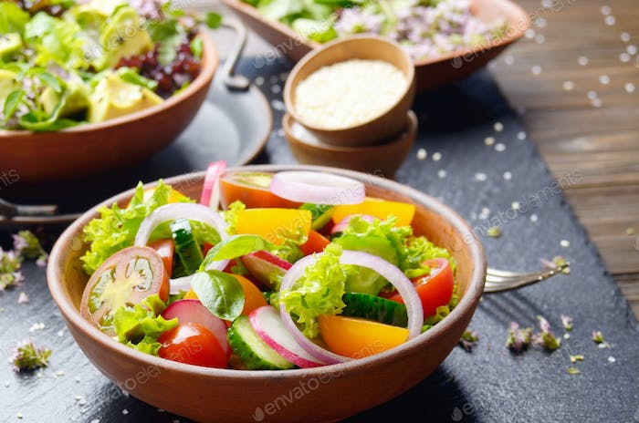 Vegetable salad of lettuce, cherry tomatoes, radish, cucumber, o