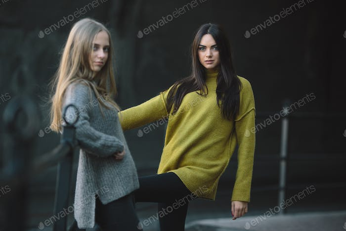 Fashion girls posing on the street